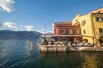 Little restaurant on the lakefront of Malcesine on the eastern shore of Lake Garda, Verona province, Veneto, Italy.