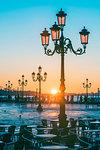 St Mark's square, Venice, Veneto, Italy. Tourists admiring the sunrise over St. Mark's waterfront.