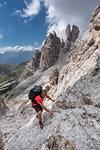 Cristallino di Misurina, Misurina, Dolomites, province of Belluno, Veneto, Italy. A climber in the ascent to the Cristallino di Misurina