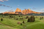 Alpe di Siusi/Seiser Alm, Dolomites, South Tyrol, Italy. Sunset on the Alpe di Siusi/Seiser Alm with the peaks of Sassolungo and Sassopiatto