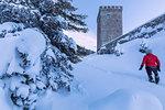 Woman on snowy path at Belvedere Tower, Maloja Pass, Bregaglia Valley, canton of Graubunden, Engadin, Switzerland