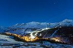 Illuminated ski area of Madesimo, Spluga Valley, province of Sondrio, Valtellina, Lombardy, Italy