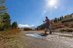 Hiker on footpath, Val Vezzola, Valdidentro, Valtellina, Sondrio province, Lombardy, Italy