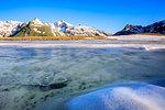 Ice melting at Lake Andossi during thaw, Chiavenna Valley, Spluga Valley, Sondrio province, Valtellina, Lombardy, Italy
