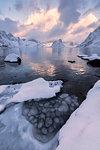 Sunset on the icy sea, Reine Bay, Lofoten Islands, Norway