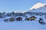 Houses surrounded by snow, Maloja Pass, Bregaglia Valley, Canton of Graubunden, Engadin, Switzerland