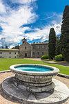 Old fountain at Piona Abbey (Abbazia Priorato di Piona), Colico, Lecco province, Lombardy, Italy