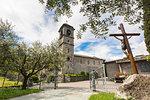Bell tower and crucifix, Piona Abbey (Abbazia Priorato di Piona), Colico, Lecco province, Lombardy, Italy
