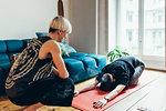 Woman teaching friend yoga at home