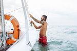 Man preparing sailboat