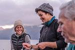 Friends having dinner by lakeside, Johnstone Strait, Telegraph Cove, Canada