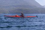 Woman kayaking in lake, Johnstone Strait, Telegraph Cove, Canada