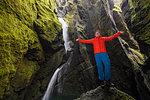 Man standing on rock, Stakkholtsgja Canyon, Thorsmork Valley, Hella, Rangarvallasysla, Iceland