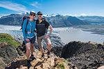 Couple standing above Skaftafellsjokull glacier, Austur-Skaftafellssysla, Iceland