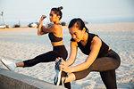 Friends doing exercises on beach, Long Beach, California, US