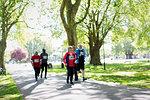 Active seniors running sports race in park