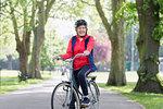 Portrait confident active senior woman riding bike in park