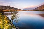 Lake at sunrise near the foot of Snowdon, Snowdonia National Park, North Wales, United Kingdom, Europe