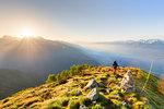 A hiker on the ridge of Mount Rolla, Valmalenco, Valtellina, Lombardy, Italy, Europe