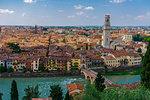 Panorama of traditional buildings with the Ponte Pietra stone Roman arch bridge crossing the River Adige, Verona, Veneto, Italy, Europe