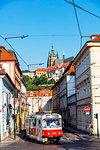 City tram, Prague Castle and St. Vitus Cathedral, Prague, UNESCO World Heritage Site, Bohemia, Czech Republic, Europe