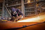 Steel cutter at work in shipyard