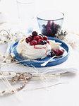 Plate of fruit meringue with cream