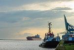 Ships docked in urban bay