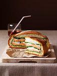 Muffuleta sandwich on cutting board