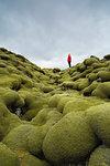 Woman walking on mossy hill