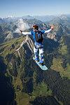 Man skysurfing over Saanen, Bern, Switzerland