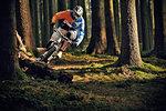 Female on mountain bike riding through forest