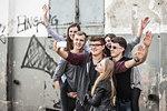 Teenagers taking selfie by abandoned building
