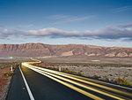 Highway headlight trails at dawn, Lanzarote, Spain