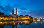 Grossmünster Cathedral, Limmat river by night, Zurich, Switzerland