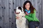 Woman bonding with pet dog