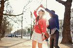 Romantic couple twirling in sunlit park, London, UK