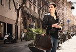 Woman using smartphone on street, El Born, Barcelona, Spain
