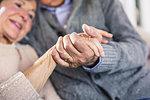 Close up of loving senior couple holding hands