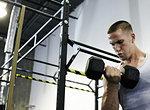 Man doing bicep curls in gym