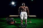 Portrait of american football player doing push ups