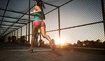 Female athlete running along walkway