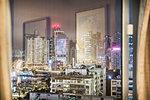 City and reflections viewed through window, Hong Kong, China