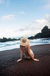 Young woman posing on beach, Hana, Maui, Hawaii