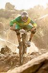 Male mountain biker racing on dusty track, Fontana, California, USA