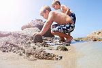 Brothers playing on beach, Laguna Beach, California, US