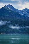 Mist over mountain lake, Haines, Alaska, USA