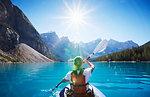 Mid adult woman kayaking, Moraine Lake, Alberta, Canada