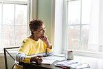 Senior woman thinking at desk