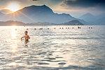 Boy wading in sea